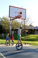 Kyle Martin, a member of the SLO Ballerz unicycle basketball team, dunks the ball at Meadow Park.