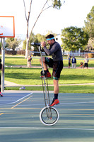 VonJon mounts a 7-foot tall unicycle at Meadow Park.