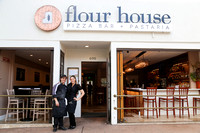 Flour House owners Gessica and Alberto Russo proudly stand in front of their restaurant.