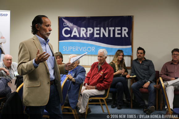 Carpenter speaks to a crowd of his supporters at the San Luis Business Center.